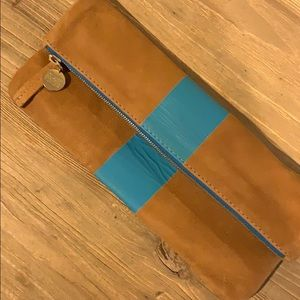 Clare foldover leather clutch with blue stripe